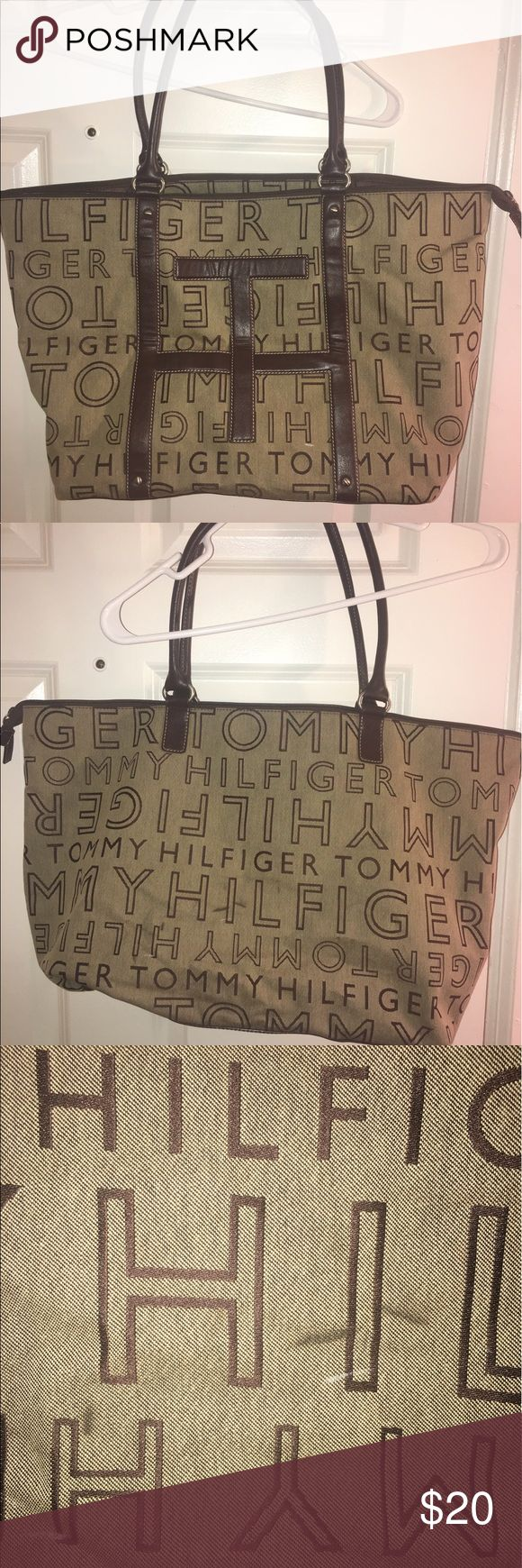 Tommy Hilfiger Tote bag! Great condition except one little mark, shown in pictures. I haven't even tried to get it off so it may come off very easily. It's a decent size bag and could be used as an everyday bag or something such as a beach bag. Tommy Hilfiger Bags Totes