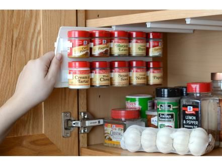 Speaking of hidden storage opportunities, this spice rack by SpiceStor mounts to the underside of a cabinet shelf and pulls out for easy access when cooking. Round spice canisters clip into place with no tools required for assembly. The rack is available in a variety of sizes to accommodate different spice containers.