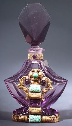 A Czechoslovakian perfume bottle, circa 1920s, in purple crystal, with jeweled metalwork.
