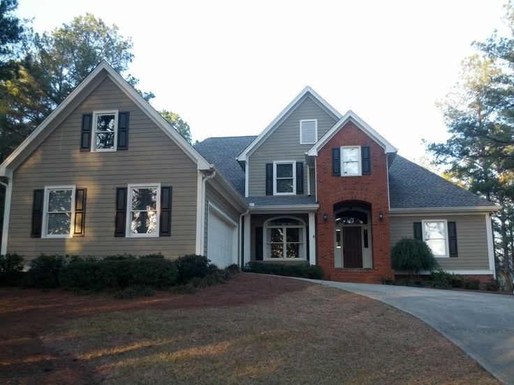 tan vinyl siding w white trim and black shutters | Home is ...