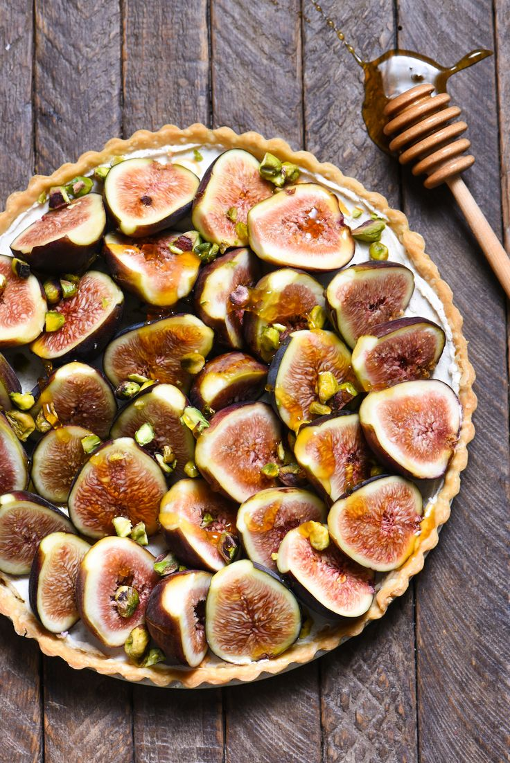 """Fig & Spiced Goat Cheese Tart - A """"dessert"""" for all the cheese lovers out there. Ripe figs are piled into a flaky crust on top of sweet and savory spiced goat cheese, then topped with honey and pistachios.   foxeslovelemons.com"""
