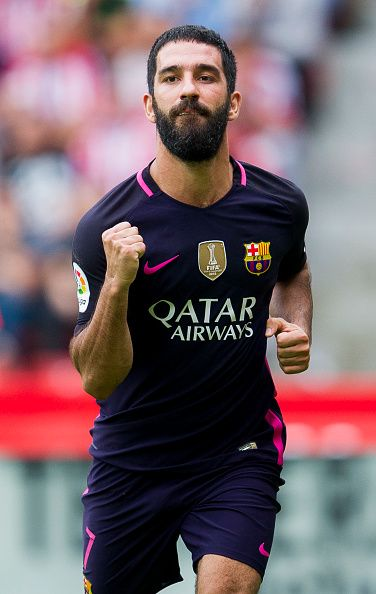 Arda Turan of FC Barcelona celebrates after scoring his team's fourth goal during the La Liga match between Real Sporting de Gijon and FC Barcelona...