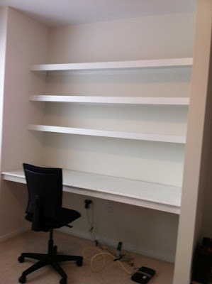 Shelves & desk, that's exactly what I'm doing but picture a large print wall paper on wall behind the shelves :)