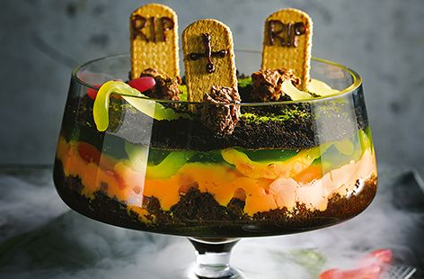 With rich chocolate brownies, vibrant orange custard and creepy green jelly, this spooky twist on a classic trifle is a scarily good Halloween party idea that will definitely impress the kids.