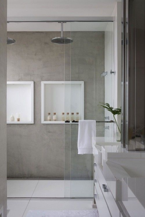 I want this! Shower head from the ceiling dual heads, concrete look, recessed shelving glass door. Just beautiful, brilliant.