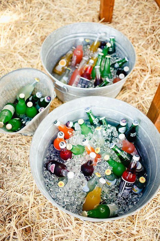 bottles in galvanized buckets