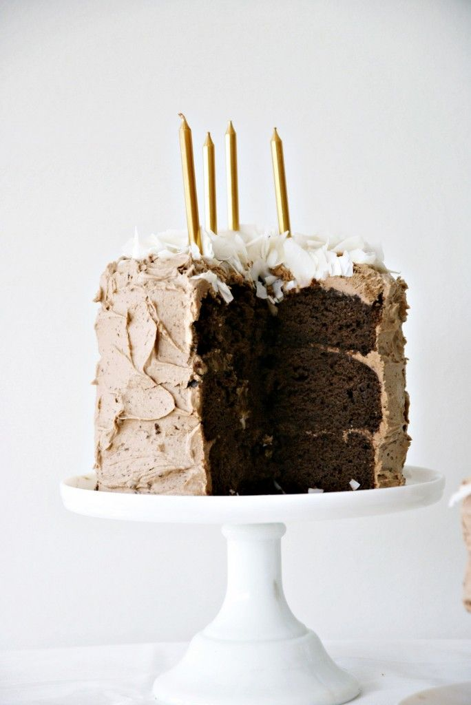 3 layer chocolate cake with buttercream and coconut flakes