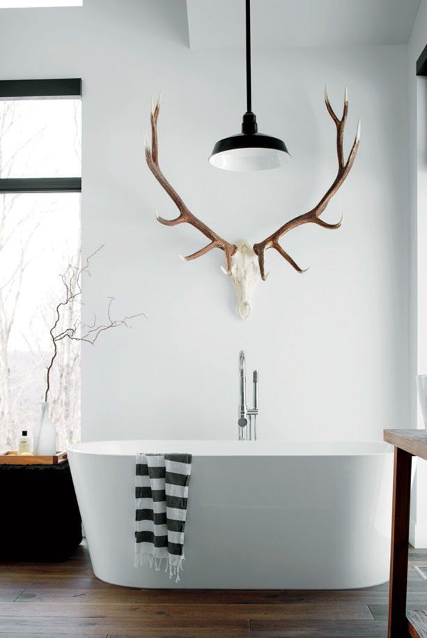 Bathroom scandinavian modern minimalist simple country house freestanding bath white walls wood floor antler vintage lamp industrial style home decorating decorate interior design interior design living inspiration bathroom