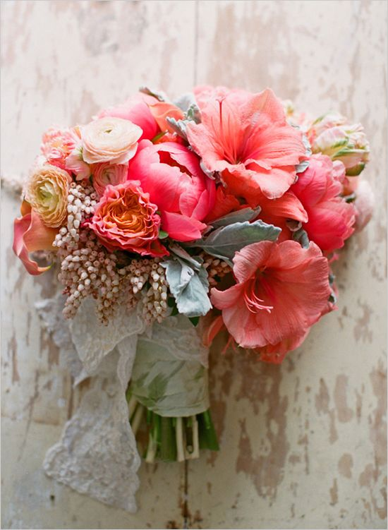 peach wedding bouquet contains the following flowers: Amaryllis, Garden Roses, Calla Lily, Dutch Tulip, Dusty Miller, Pieris, Peonies, and Ranunculus