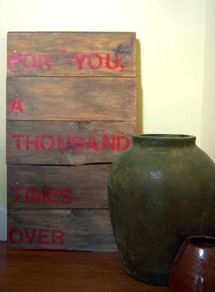 """A favorite quote (from """"The Kite Runner"""") on reclaimed wood."""