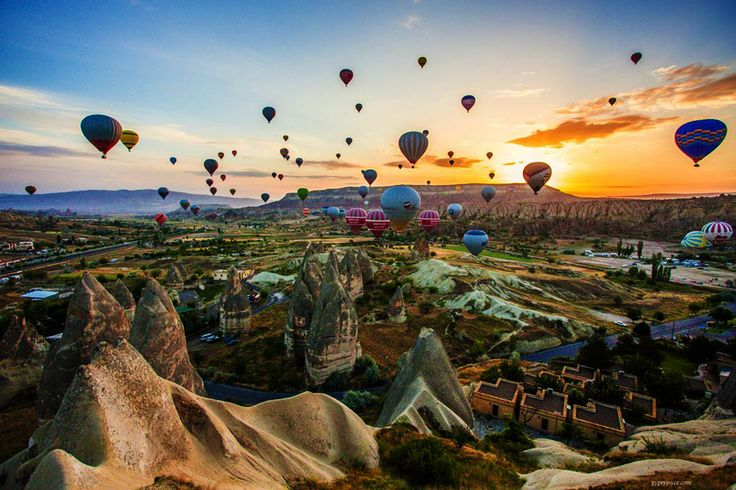 Take a hot air balloon ride at sunset in Cappadocia, Turkey.