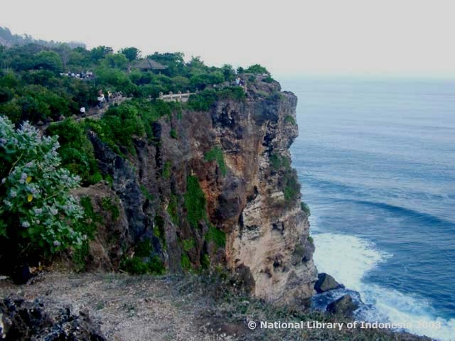 Uluwatu Temple sits on a 70-meter-high cliff protruding above Indonesian Ocean. Because of its unique location, visitors to the temple have to take a long stone stairway to reach it. The temple heads east, unlike other Balinese temples which face west or south.