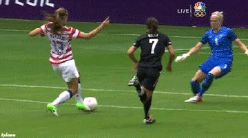 Alex Morgan taking a goalie down  I'm glad I didn't do that