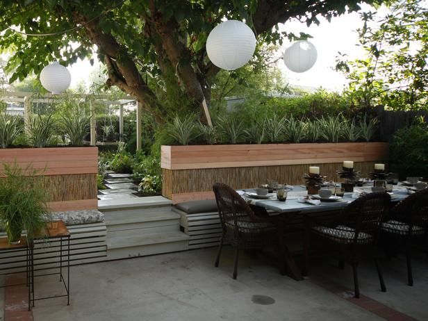 The dining table and chairs are easily moved to transform this patio into an informal gathering space, as seen on The Outdoor Room by Jamie Durie on HGTV.