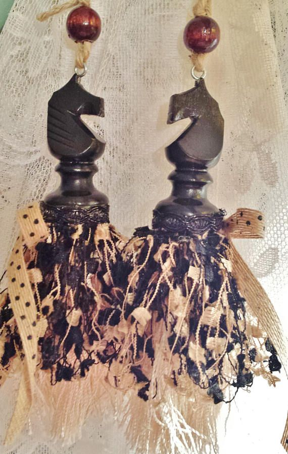 Two Black Knights - Pair of black wooden knight chess pieces sporting ivory, beige and black trim with a dangling bell under the skirt.