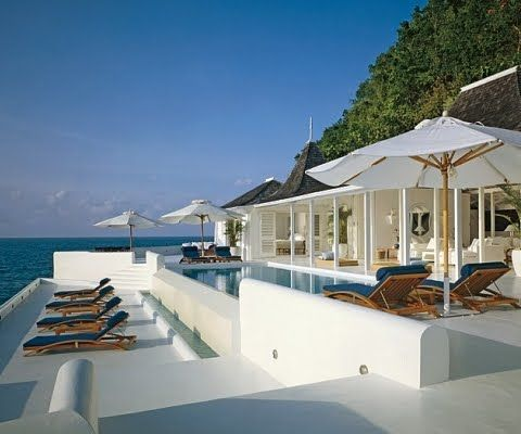 Ralph Lauren's Seaside Home in Montego Bay, Jamaica featuring Summit Sundeck Chaise Lounges.