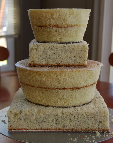 Shaping cake layers. Learn How to Decorate Cakes - Visit Online ABC Cake Decorating Classes on http://CakeDecoratingCoursesOnline.com