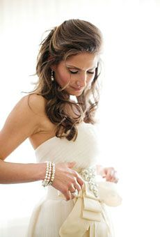 Brides: 21 Romantic Wedding Hairstyles  - A Half-Up, Curled Wedding Hairstyle  Does it get any more romantic than pearls and curls? Soft tendrils swept into a half-updo look perfect with classic pearl drop earrings.