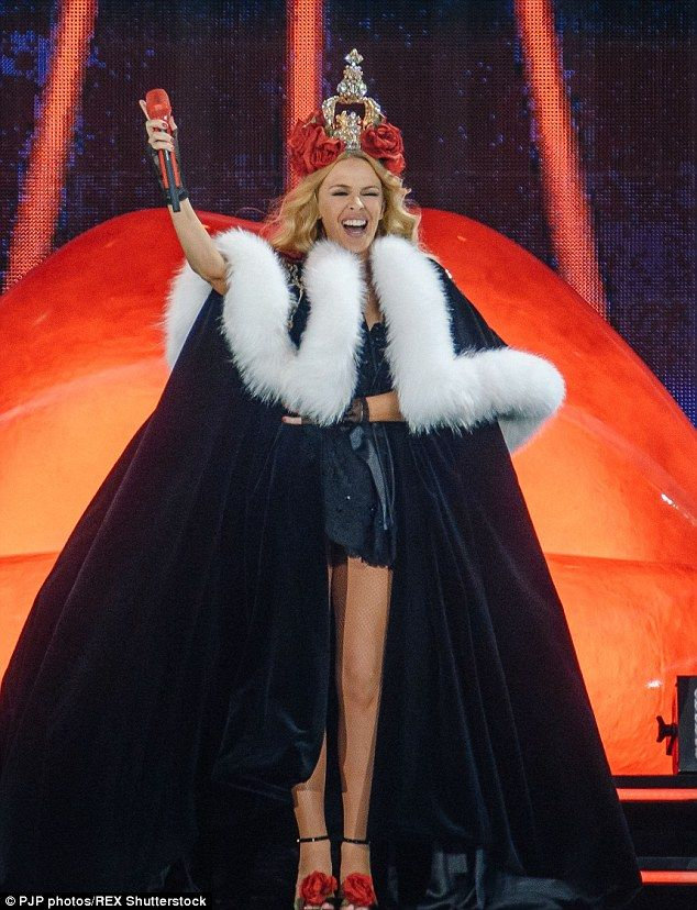 Having a blast! Kylie beamed as she looked out to the crowd from the stage as they cheered...