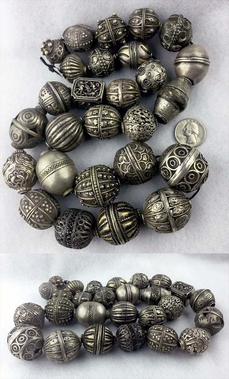 Collection of 27 Antique silver beads; includes beads from Morocco, Yemen, India, Egypt, Afghanistan, Nepal, Somalia, etc
