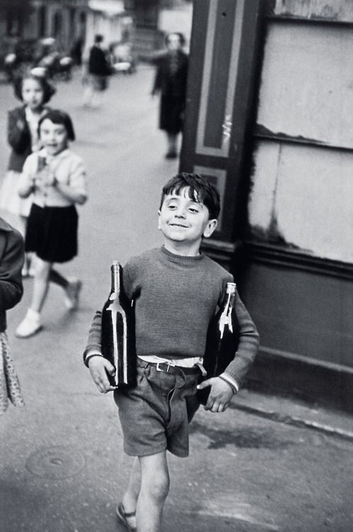 """Rue Mouffetard, Paris, 1954  Henri Cartier-Bressonwas a French photographer considered to be the father of modernphotojournalism. He was an early adopter of35mmformat, and the master ofcandid photography. He helped develop the """"street photography"""" or """"life reportage"""" style that has influenced generations of photographers who followed."""