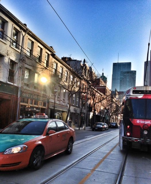 #Toronto #ttc #thediamondstudio Love this picture and the juxtaposition of the streetcar and the taxi in the shot.