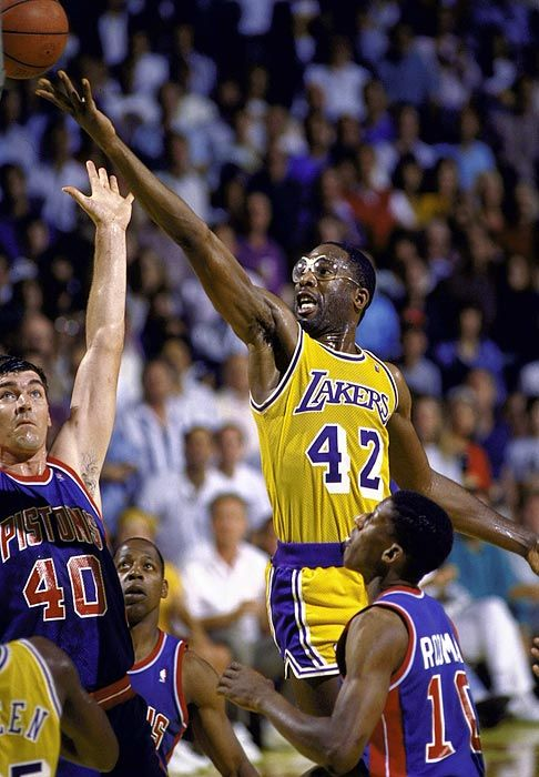 James Worthy... Hall of Famer, and still underrated... King of the 'One-handed, palm the ball, back to the basket, turn to face the basket, and drive to the hole' move...