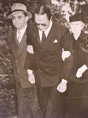 William Powell being supported by his mother Nettie (and screenwriter Otis Wiles) at Jean Harlow's funeral
