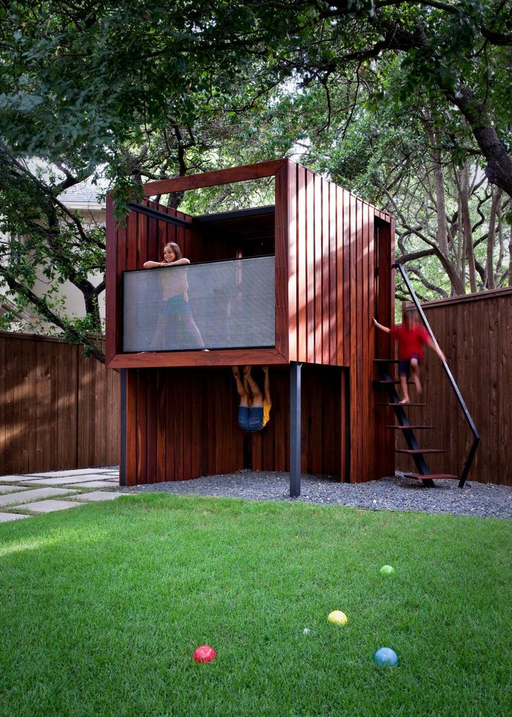 HGTV presents a modern outdoor living, dining and play area with a color-changing play structure, an outdoor kitchen, and a modern seating area with fire pit.
