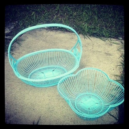Vintage wire baskets spray painted. I want to find cheapy, icky wire baskets like this and paint them pretty colors! Would be awesome to organize the pantry with!