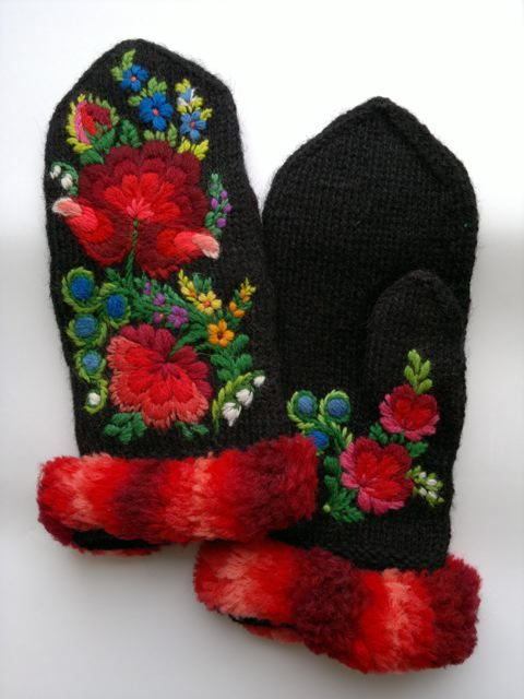 Folk-art embroidery in Dala-Floda style on mittens knit in the twined knitting technique.