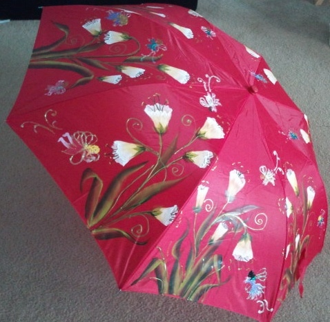 Magical fairies sprinkly glittering fairy dust on this large hand painted umbrella - $45