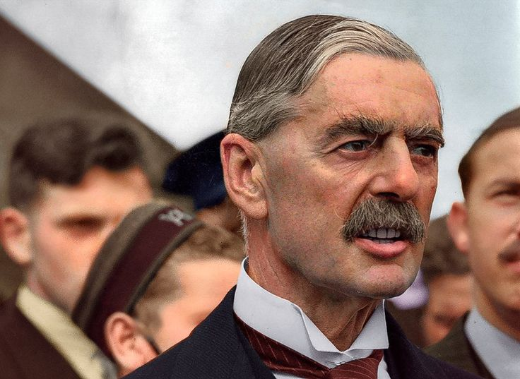 Marina Amaral - Photo Colorization British Premier Sir Neville Chamberlain, on his return from talks with Hitler in Germany, at Heston airfield, London, England, on September 24, 1938. Chamberlain brought with him a terms of the plan later to be called the Munich Agreement, which, in an act of appeasment, allowed Germany to annex Czechoslovakia's Sudetenland. | If you want to commission me: http://www.marinamaral.com/contact-2/