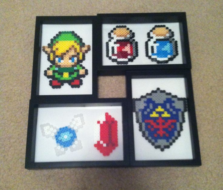 Legend of Zelda photo set includes Link, Health/mana potions, Rupee, navi, and shield. Whole set is $40 and includes frame and backgrounds.
