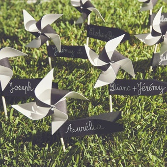 pinwheels and escort cards. Gold and peach vs black and white - would look pretty in the grass