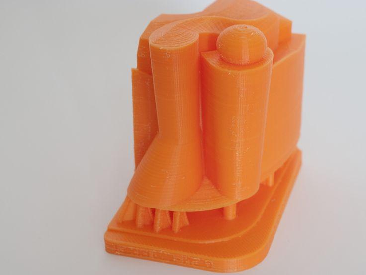 Ukázka tisku pro zájemce o 3D tiskárnu, tisk jeho modelu. 3D tiskárna Rebel 2, oranžové ABS, tryska 0,5 mm, výška vrstvy 0,1 mm. Celková výška modelu asi 9-10 cm.