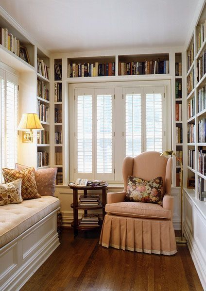 Wonderful light for reading, comfy chair, window seat, wood floor and books everywhere!