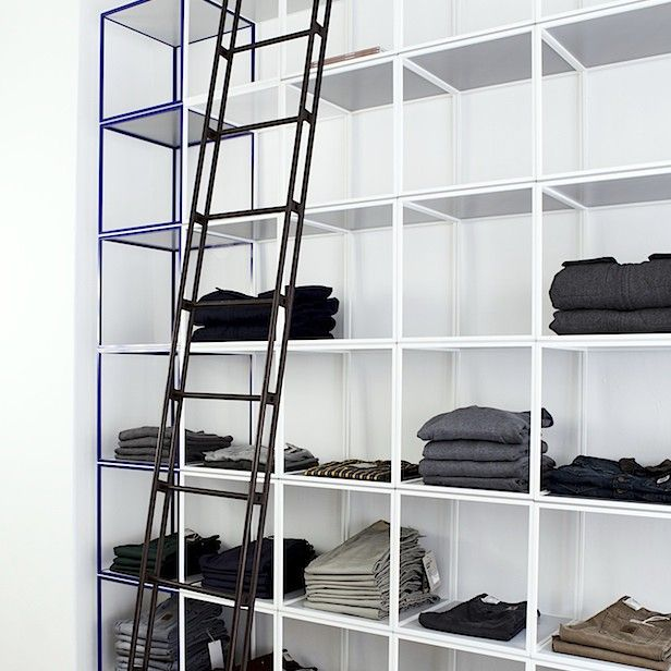 An old building ladder to break the clean look of the metal shelves