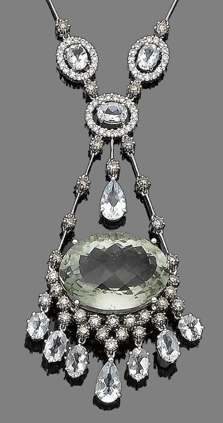 A green quartz, aquamarine and diamond pendant necklace.  The large oval faceted green quartz, within a brilliant-cut diamond surround of brown tint, suspending oval-cut and pear-shaped aquamarines, surmounted by a trio of oval-cut aquamarine and brilliant-cut diamond clusters, to a knife-wire chain spaced by similarly-cut diamonds of brown tint, diamonds approx. 2.45cts total, brown diamonds untested for natural colour, lengths: pendant 6.2cm, chain 40.7cm, extension included 7cm
