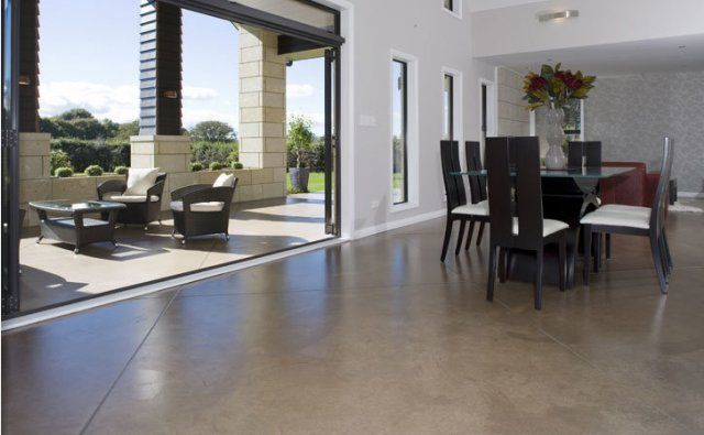 Indoor/Outdoor flow created by smooth concrete with PFL #469 oxide. Big 2m cuts offset 45 degrees
