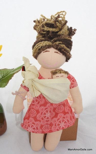 This beautiful mama doll is an original MamAmor Mini doll. She is a simplified version of the MamAmor Classic doll. This doll can give birth, and breastfeed her