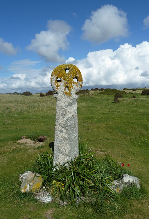 The three holed granite cross of St. Piran near the church, Penhale Sands, Perranporth
