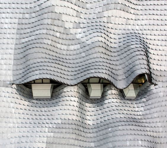 Handmade zinc scales rooftop designed by GilBartolome Architects in South Spain 2014