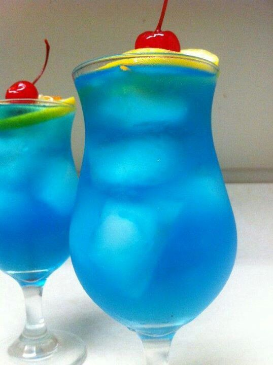 Blue Long Island Iced Tea  *1/2 oz. (15ml) Vodka  *1/2 oz. (15ml) Tequila  *1/2 oz. (15ml) Rum  *1/2 oz. (15ml) Gin  *3/4 oz. (22ml) Blue Curacao  *This drink DOES NOT have any mixers in it. Build it over ice and shake it vigorously so that the water from the melted ice acts as a mixer and softens the drink up for you.