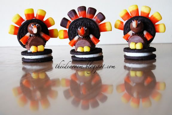 Double Stuff Oreos (2 per turkey)  Small Reeses' Peanut Butter Cups (1)  Whoppers (1)  Candy Corn  White Frosting   Black Frosting