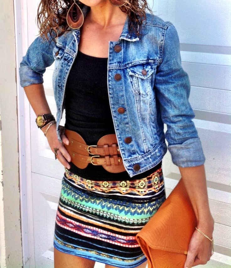 From the Aztec print skirt - oversized double buckle belt- simple tank- distressed jean jacket- and oversized leather clutch - this outfit is FAB
