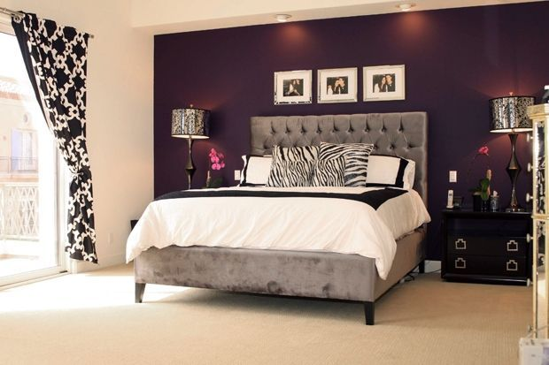 deep purple accent wall behind bed, dark furniture and gray tufted headboard. Only instead of black and white, use crystal lamps and decor-more romantic!