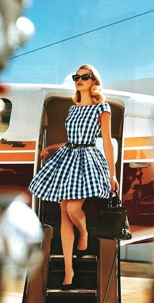 50s-style drama - gingham dress & cats-eye sunglasses.