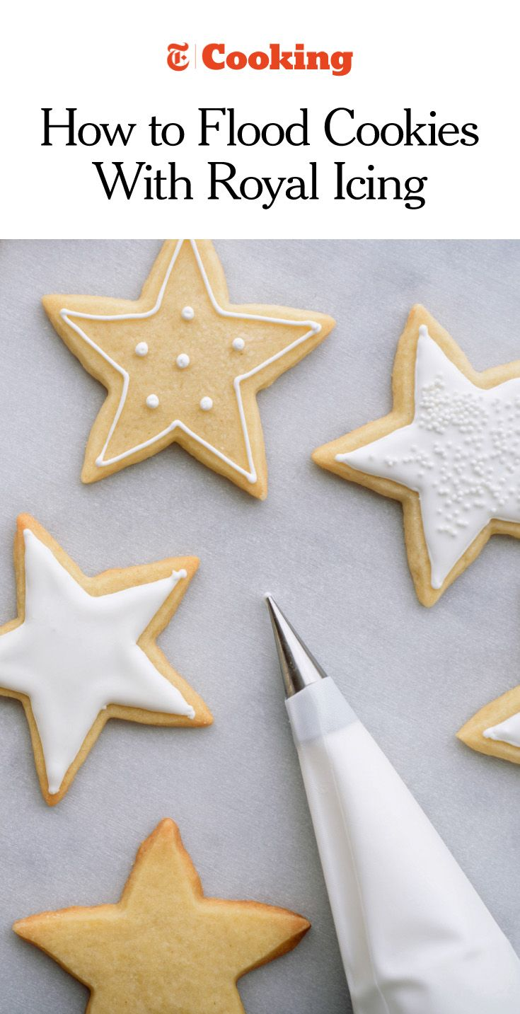 "To create a smooth, evenly frosted appearance, you'll want to ""flood,"" or fill, the surface of the cookie with icing. While a pristine white coating can be striking in its simplicity, fresh icing can serve as a glue for sprinkles, edible glitter or colorful sugars. Alternatively, it can be left to dry until hardened and used as a canvas for painting. (Photo: Karsten Moran for NYT)"