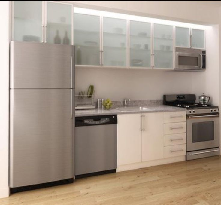 for a sleek clean look we designed this kitchen for our clients wall street apartment using aluminum frame frosted glass wall cabinets and white high gloss